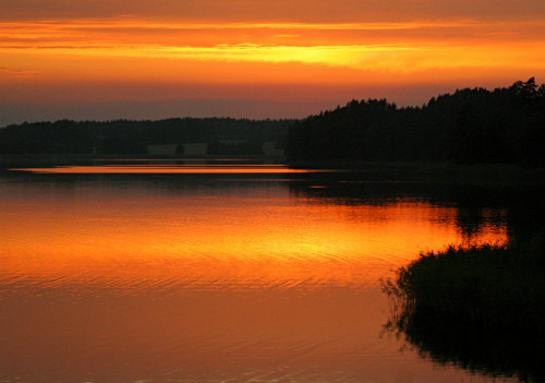 Stunning sunset over lake in Sweden