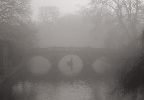 Punting under Clare Bridge in the mist