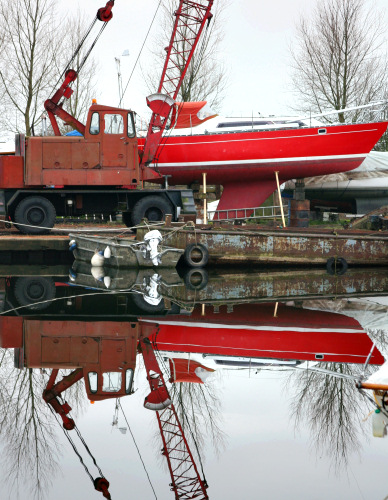 Red boat with perfect reflection