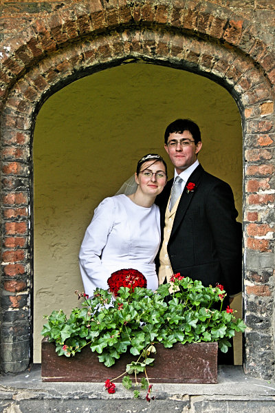 Wedding bride and groom in window arch