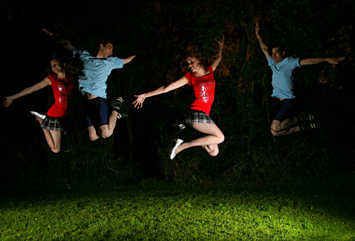 Single exposure, double flash - people jumping