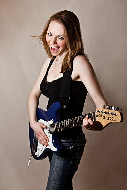 Fun girl posing with guitar
