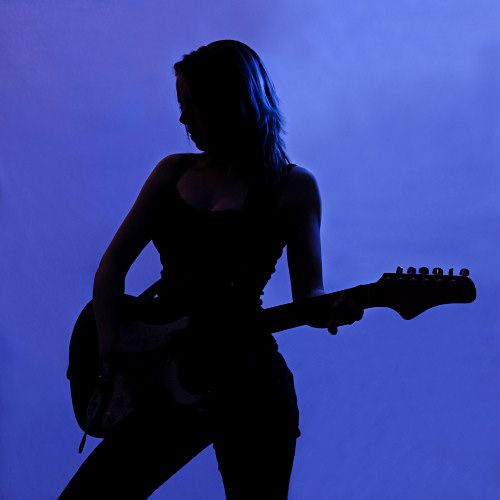Silhouette of girl with guitar