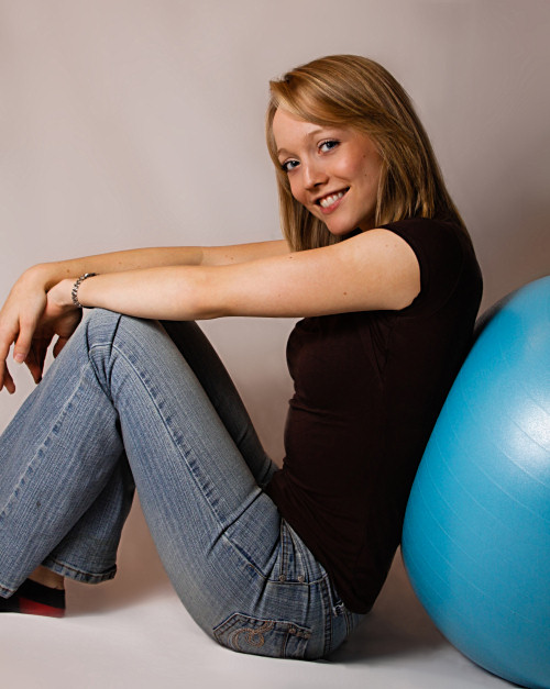 Girl leaning against exercise ball