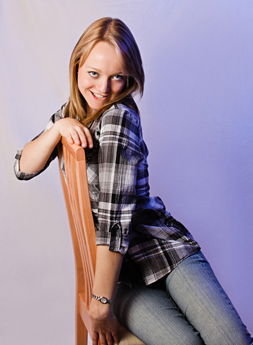 Girl leaning against chair