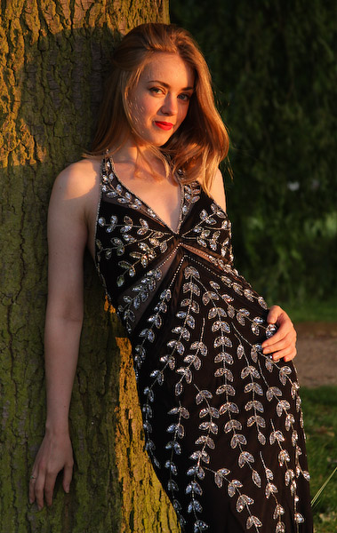 Samantha, model learning against tree at sunset