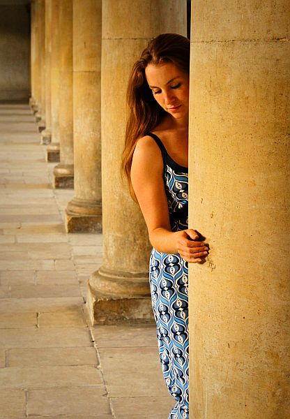Woman modelling against columns