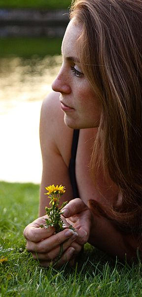 Woman with dandelion flower