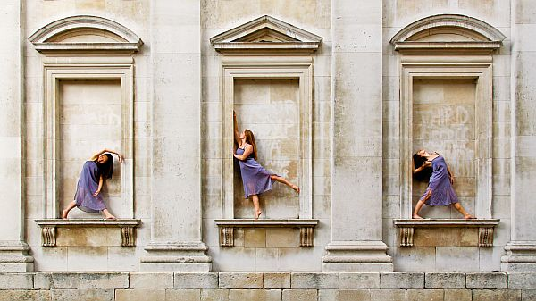 Dancers in stone alcoves