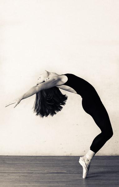 Ballet dancer arching backwards on pointe