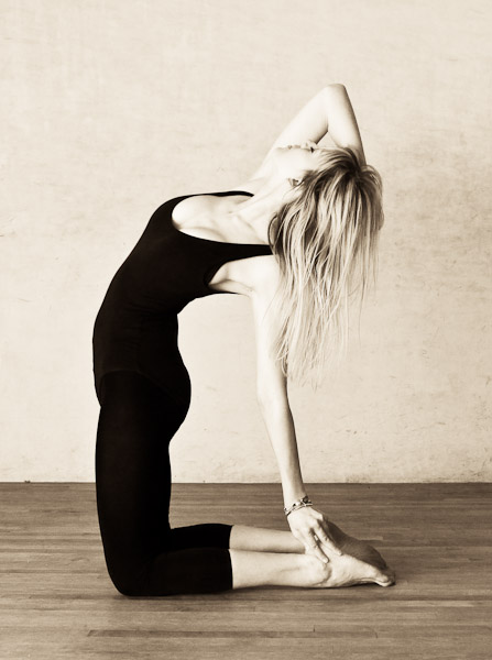 Dancer in camel yoga pose