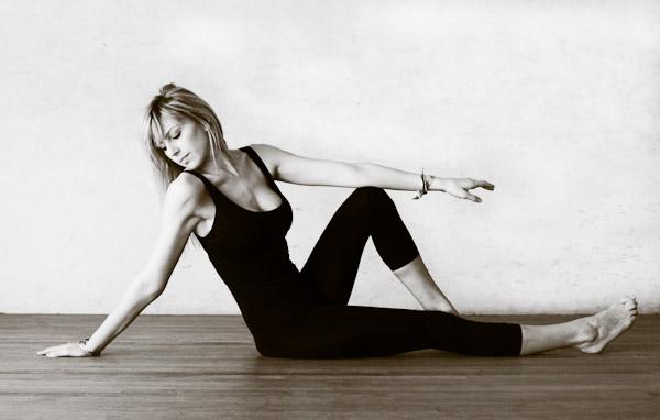 Dancer reclining on floor