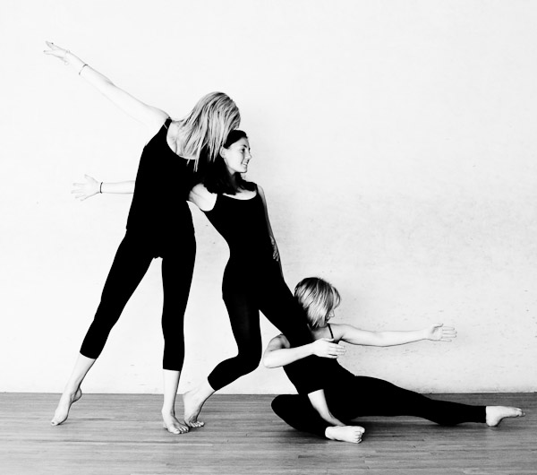 Three dancers posing together