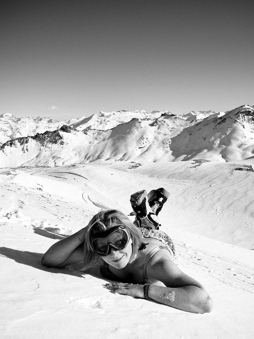 Female snowboarder in underwear