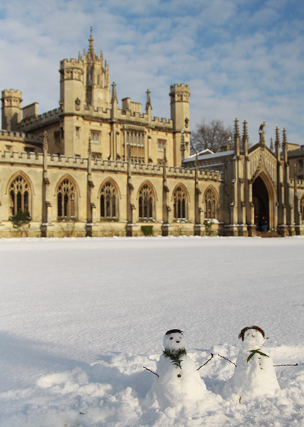 Cute snowmen in front of St. John's College, Cambridge