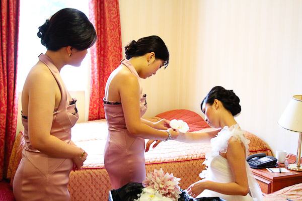 Bridesmaids Helping with Finishing Touches