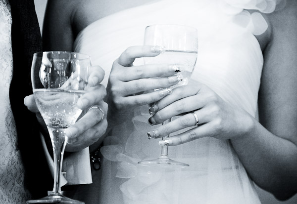 Bride and Groom with Drinks and Wedding Rings